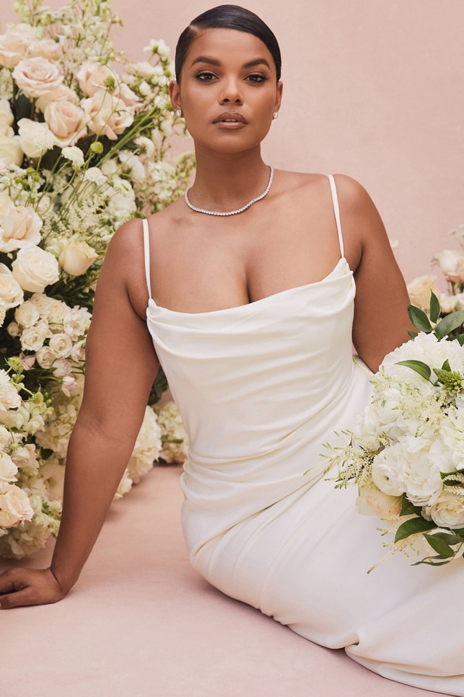 Draped ivory plus size wedding dress with spaghetti straps