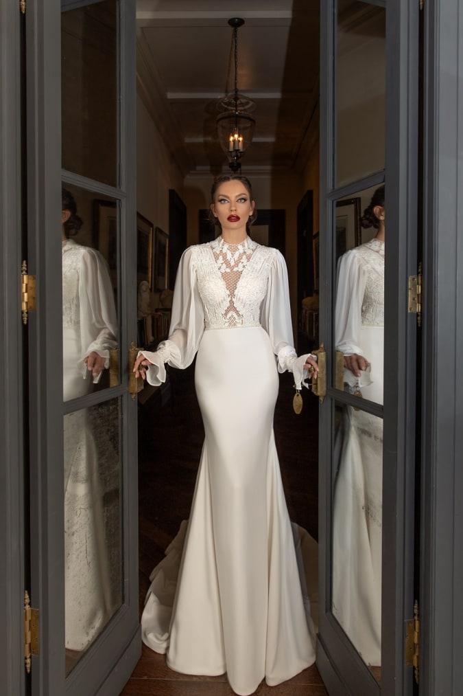 Woman wearing a long sleeve deisgner wedding dress