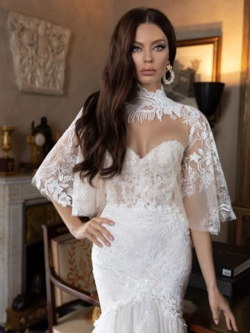 Ovory bridal gown with lace cape