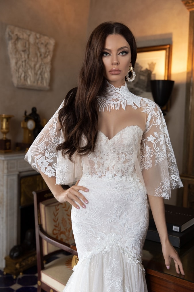 Ivory bridal gown with lace cape