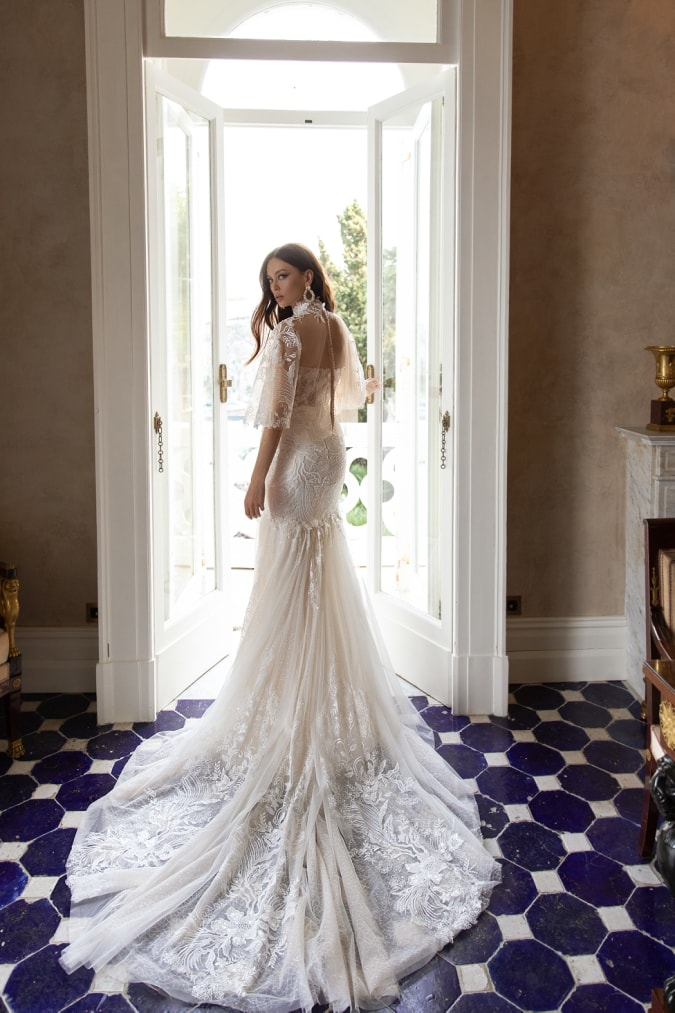 Long lace wedding dress with lace cape
