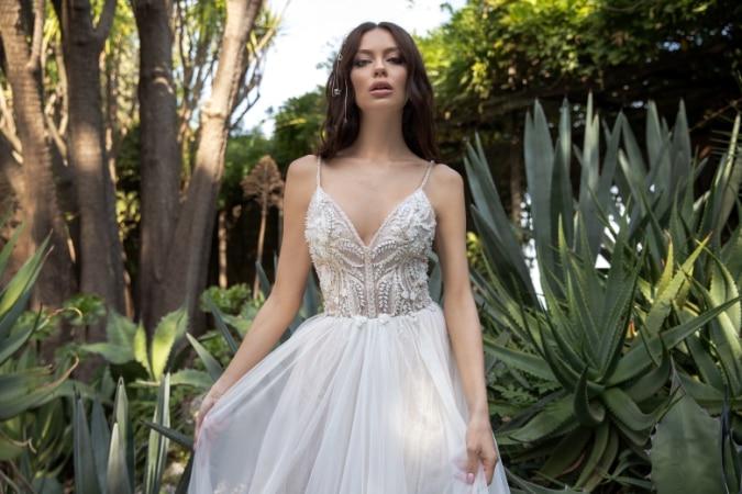 Model in a beaded spaghetti strap wedding dress