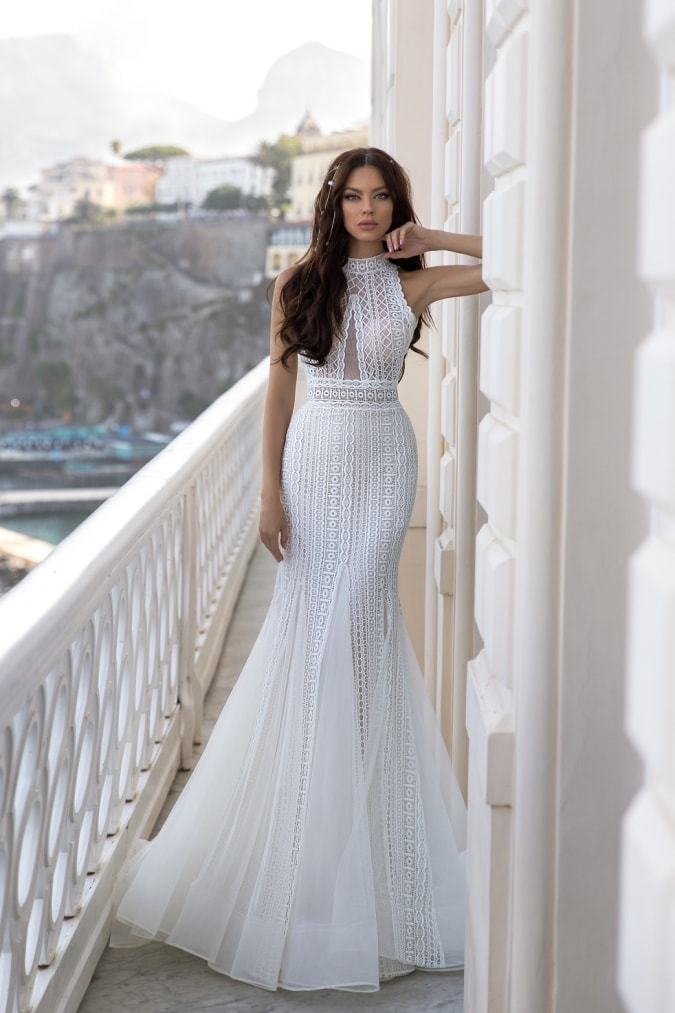 Mermaid lace wedding dress with high neck in beautiful backdrop