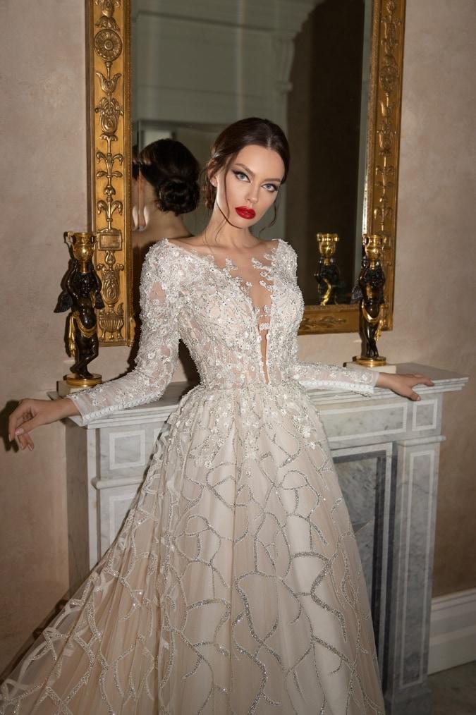 Woman wearing a long sleeve beaded wedding dress