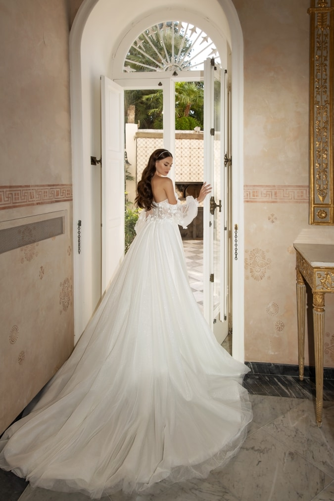 Gorgeous bridal gown with long tulle train cape