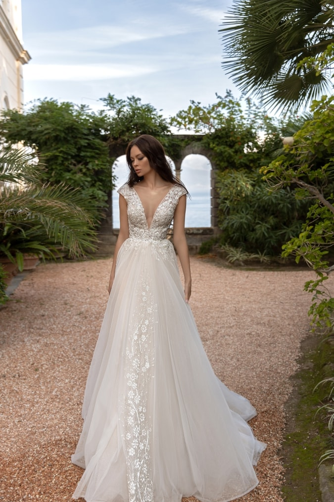 Plunging neckline on a short sleeve lace and tulle wedding dress