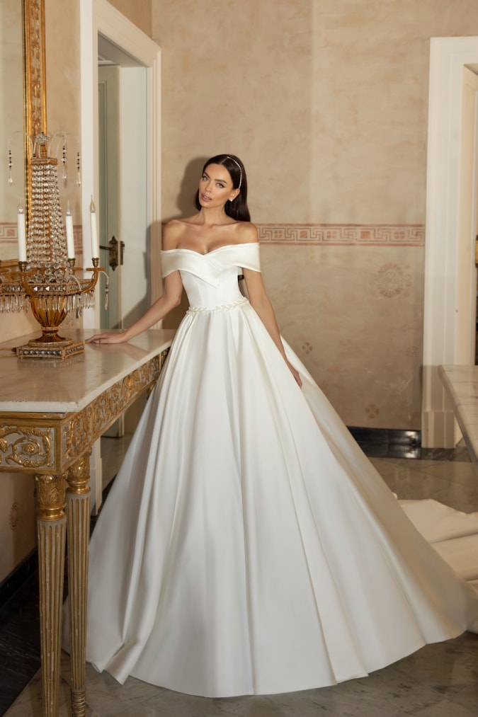 Off the shoulder ball gown wedding dress on a model