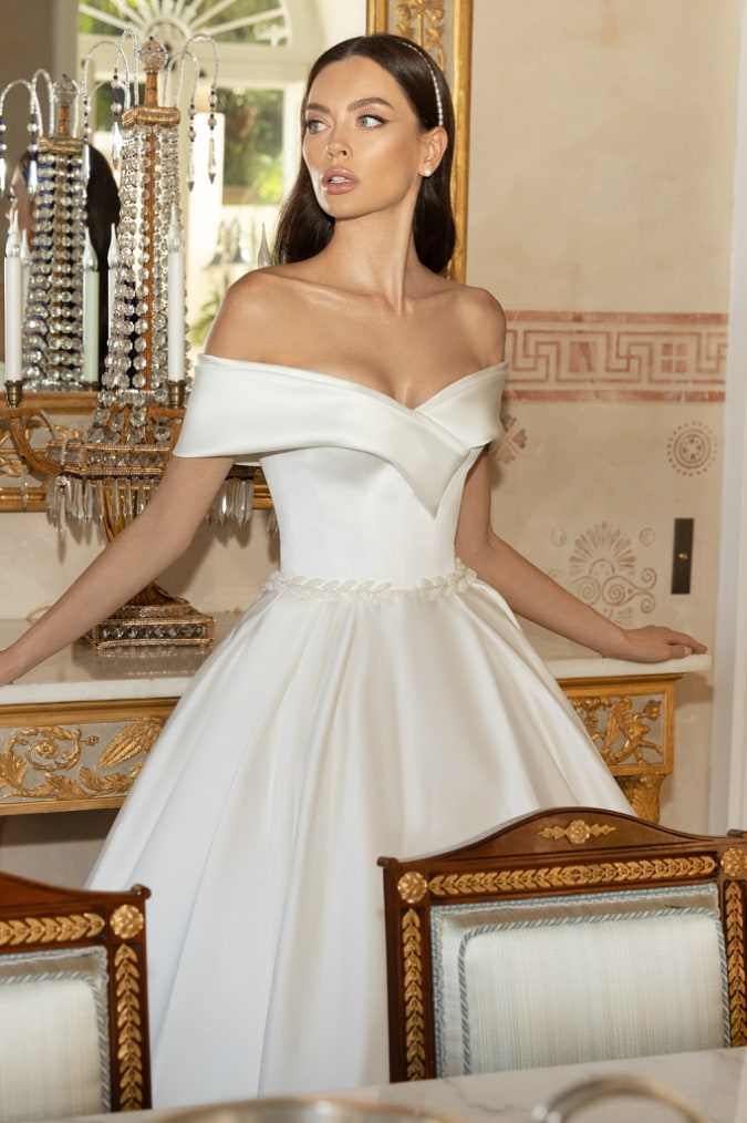 Ball gown wedding dress with off the shoulder detail close up view