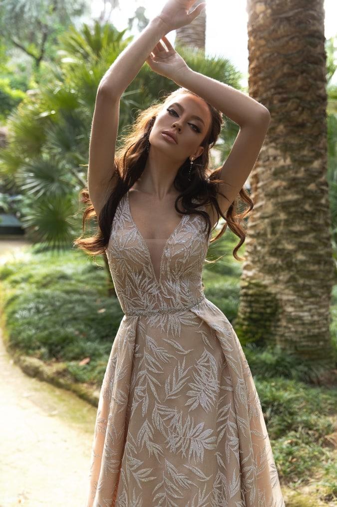 Model in an neutral lace dress