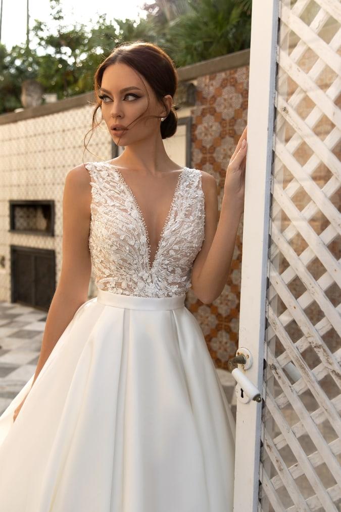 Model in a v neck wedding dress
