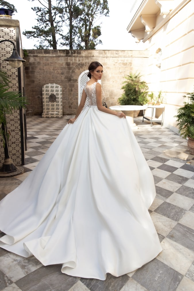Wedding dress with a long ivory full ballgown skirt and train
