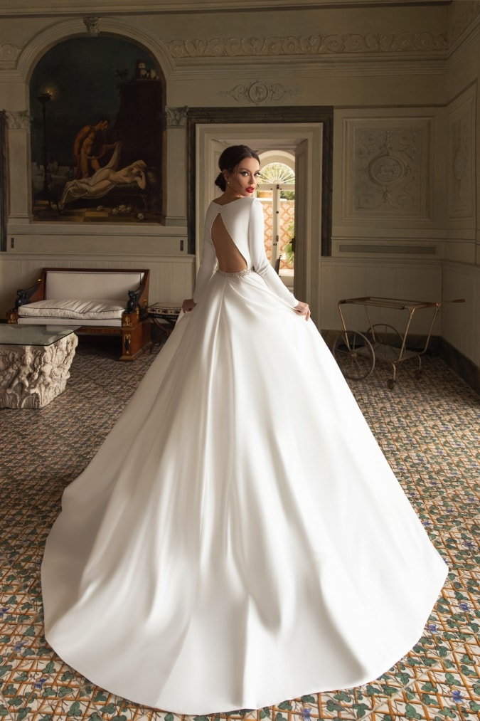 Ivory ball gown with keyhole back and long sleeves