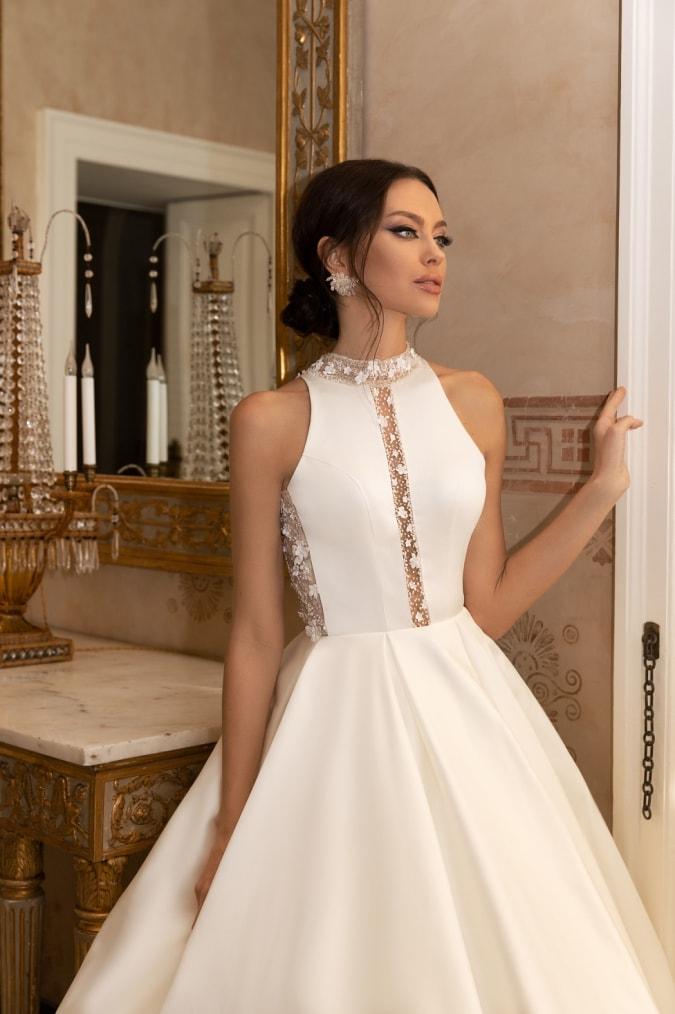 Model in a high neck sleeveless ballgown wedding dress