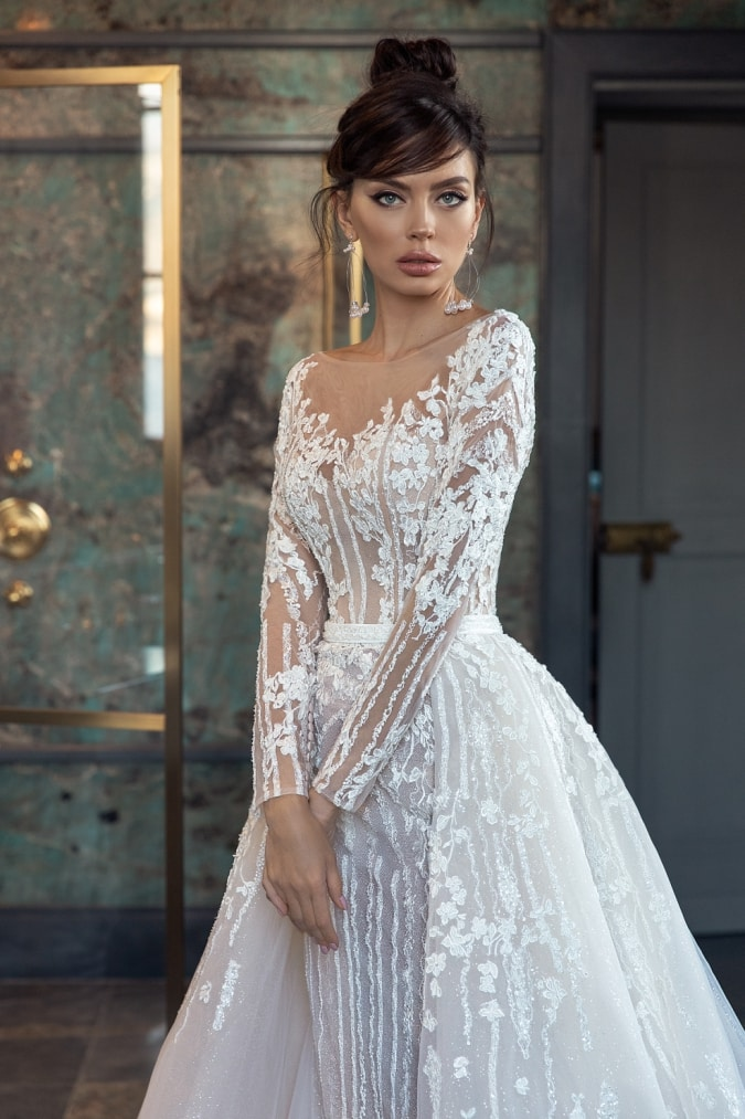 Long sleeve lace wedding dress with overskirt