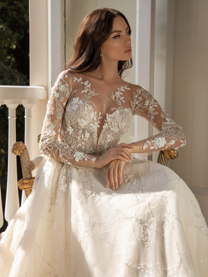 Embellished long sleeve wedding dress with illusion detail and plunge neckline