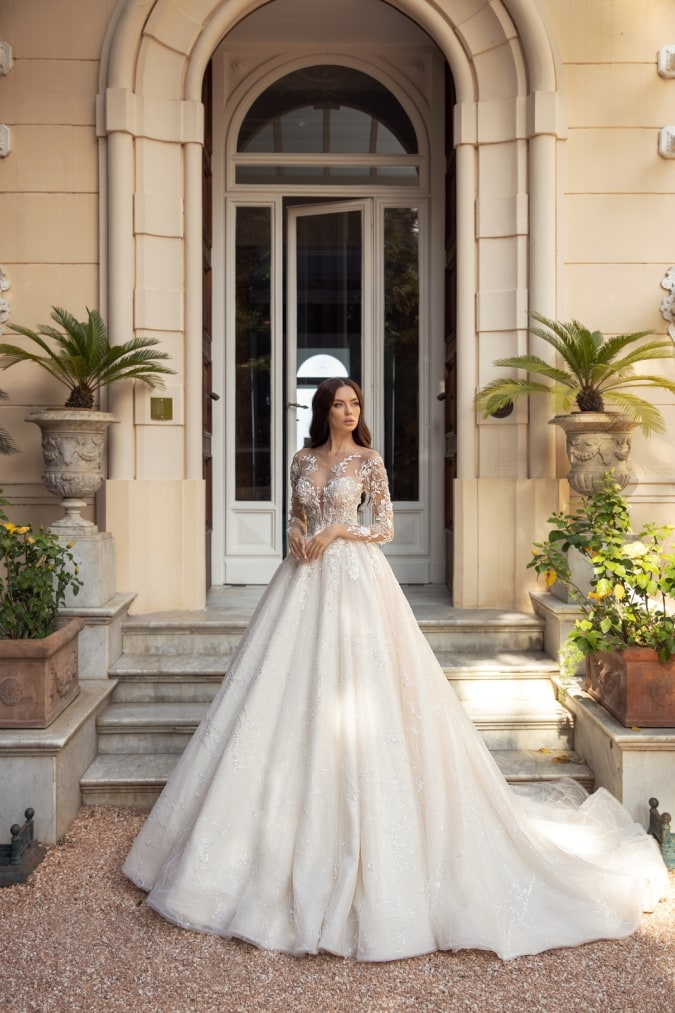 Ball gown wedding dress with long lace sleeves