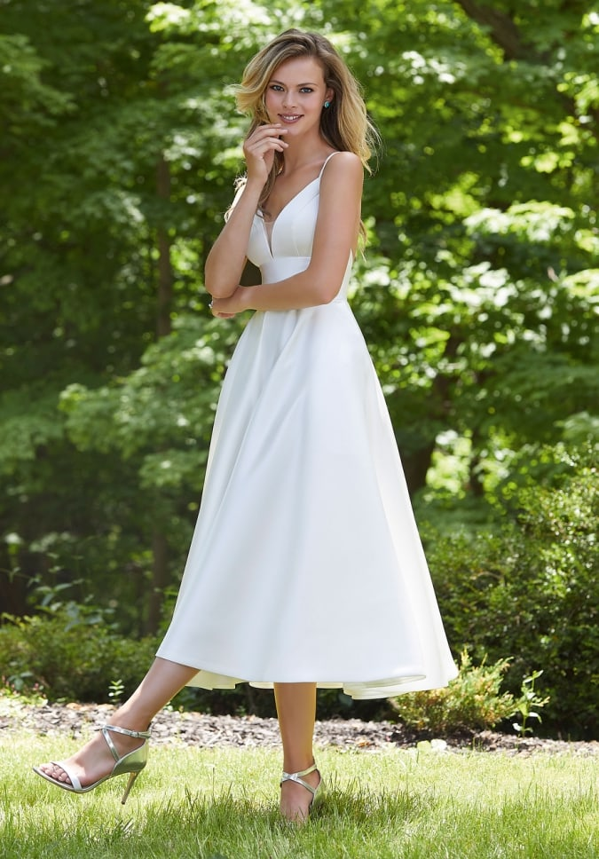 Tea length white weding dress with spaghetti straps and v neck