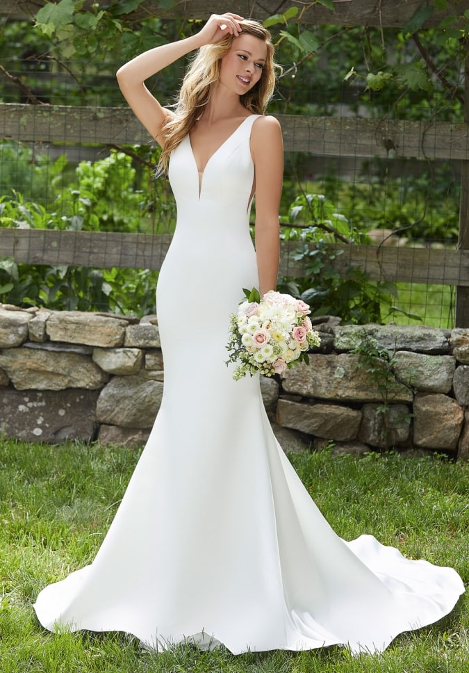 Wedding dress with plunging V neckline, wide straps, side cutouts, deep back, simple mermaid