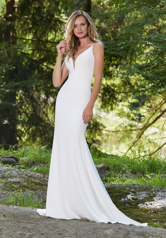 Fit and flare long simple sleeveless white wedding dress with plunging dneckline