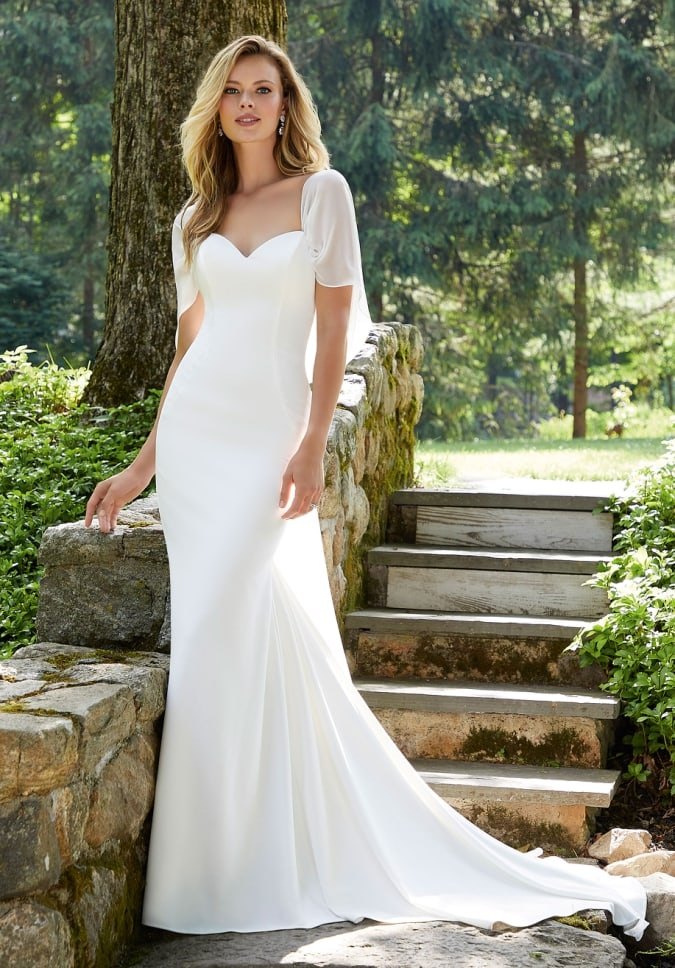 Ivory crepe fit to flare gown with detachable chiffon drape