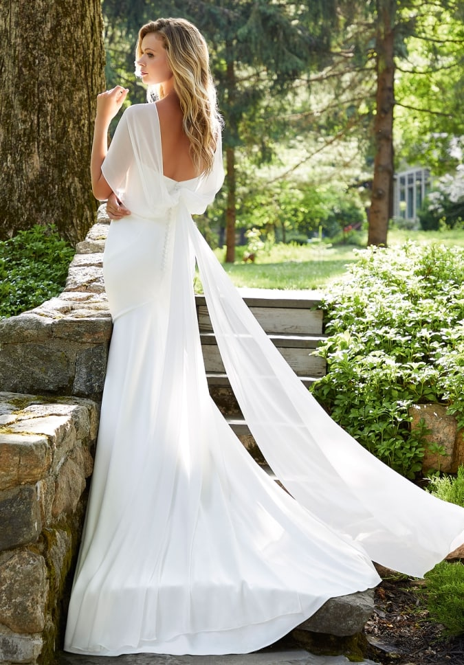 Simple wedding dress with shoulder drape