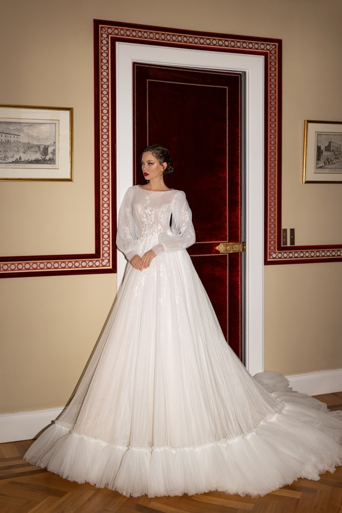 Long blouson sleeve wedding dress with embroidered detail and full skirt