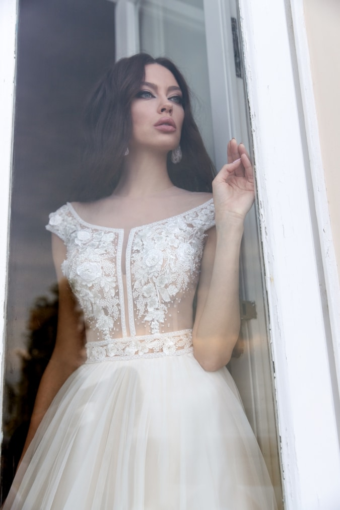 Illusion bodice wedding dress with corset cap sleeves and floral detail