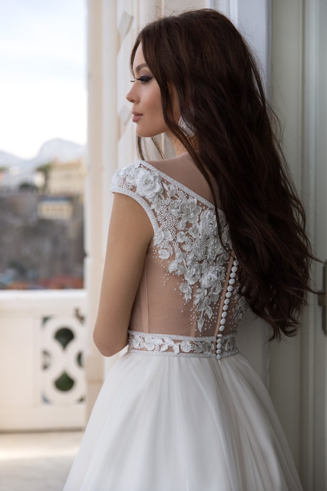 Illusion bodice wedding dress with beaded details and buttons