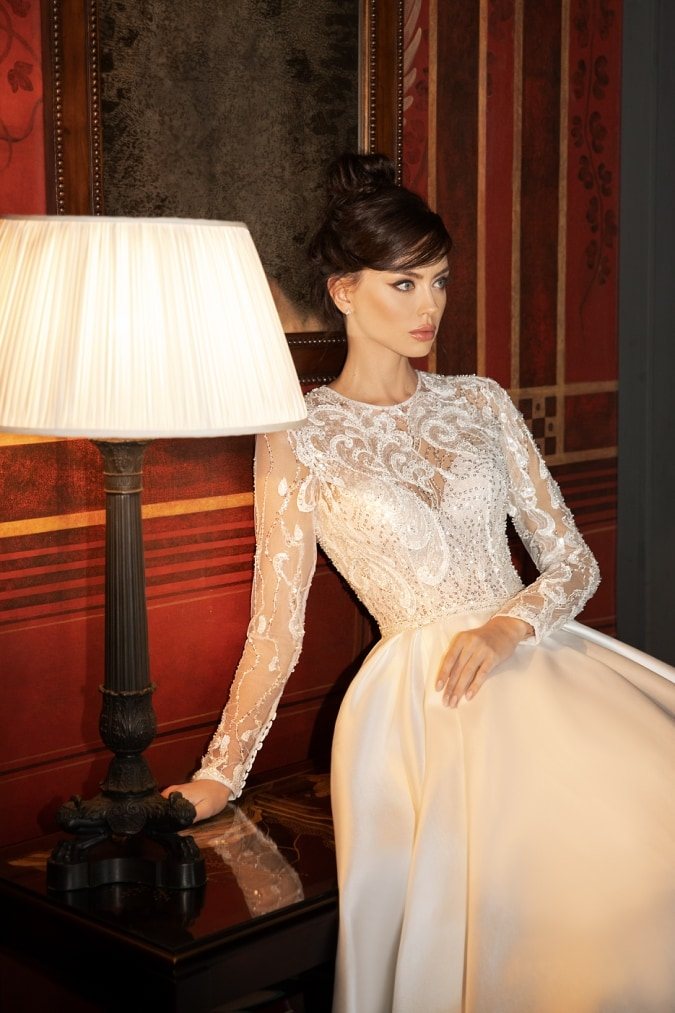Long sleeve lace sheer bodice couture wedding dress with sweetheart neckline