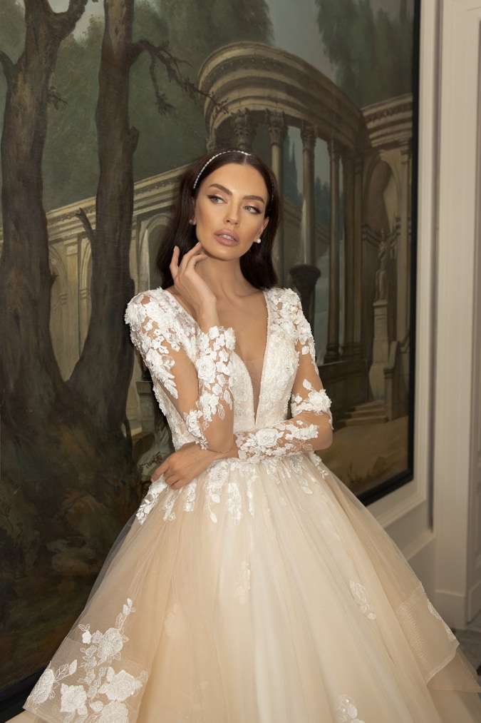 Plunging v neck wedding dress with long sleeves and full tulle overskirt with tiers