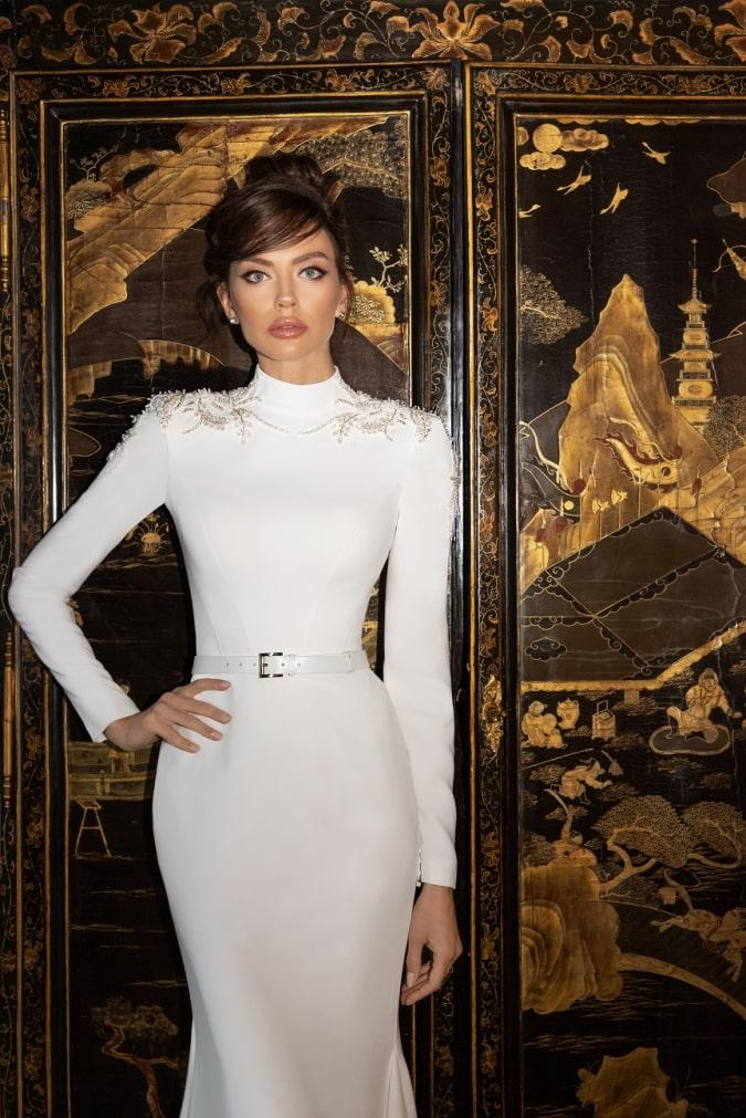 Long sleeve high neck designer wedding dress in ivory