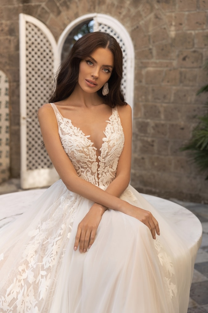 Detail of lace plunge neck bridal gown
