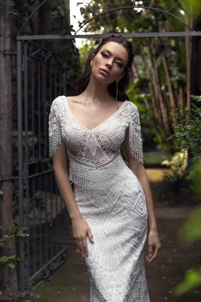 Close up of fitted lace wedding dress with half sleeves