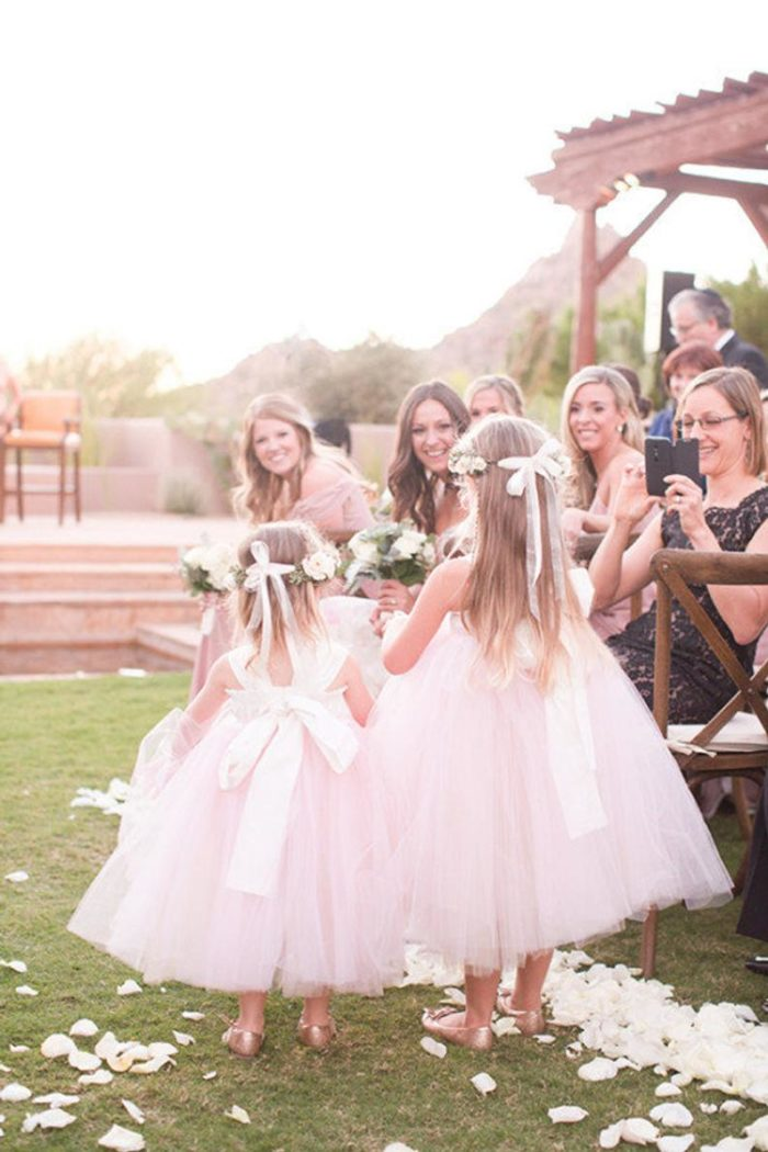 Two flower girls in pink tulle dresses
